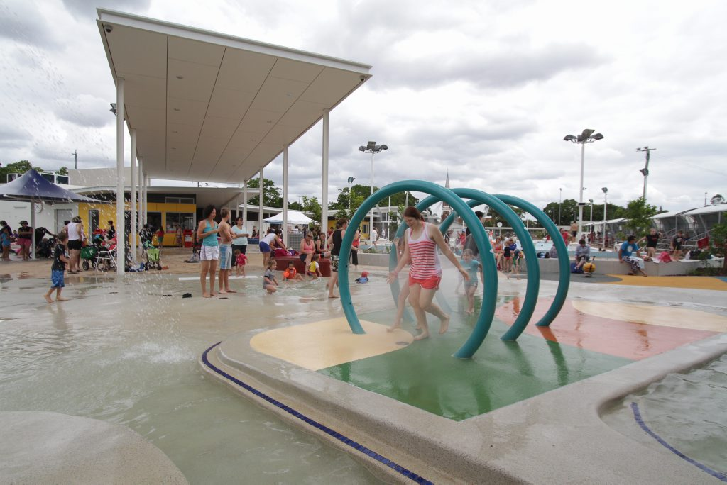 Gabby Harris runs through one of the funky water features at the Maryborough Aquatic Centre opening.