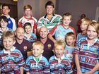 Former Brisbane Broncos players Kerrod Walters and Allan Langer with Ipswich junior rugby league players at the historic announcement.