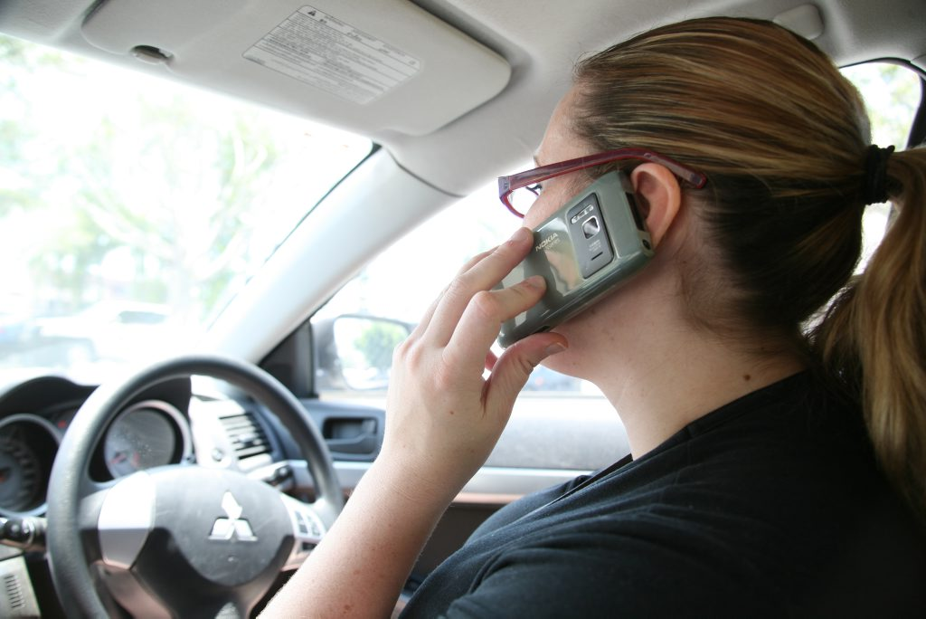 RACQ wants  a mobile phone detection camera trial in Queensland.