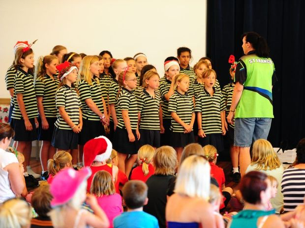 St Francis Catholic Primary School students sing at the Boyne Tannum Community Centre's Christmas tree decorating extravaganza.