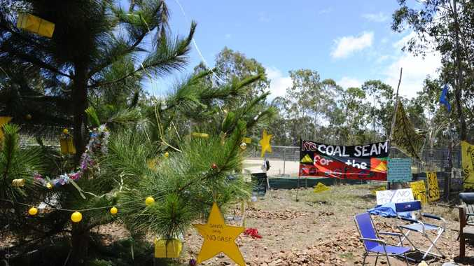 A Christmas tree stands at the site of the CSG protest at Glenugie.