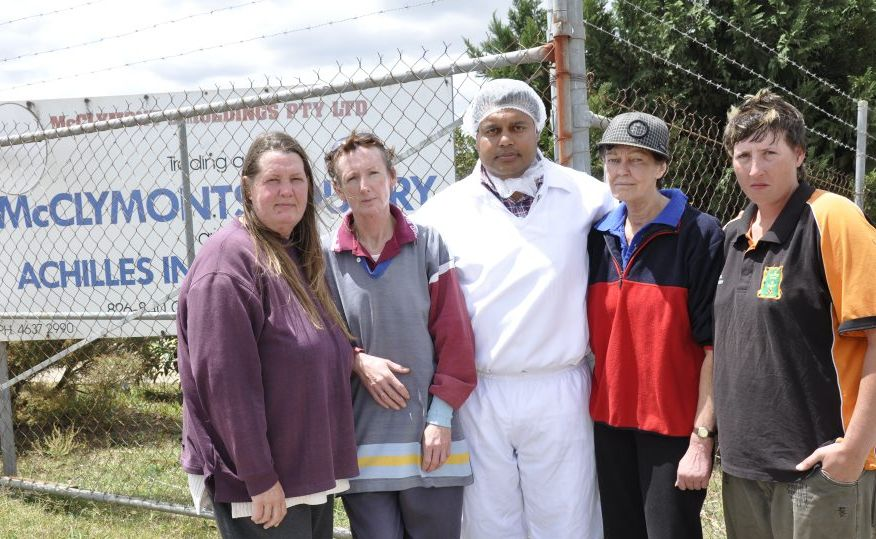McClymont's Poultry abattoir casual workers (from left) Tanya Prause, Roseanne Payne, Jai Singh, Julie Chalmers and Megan Hohenhaus console each other after being sacked yesterday.