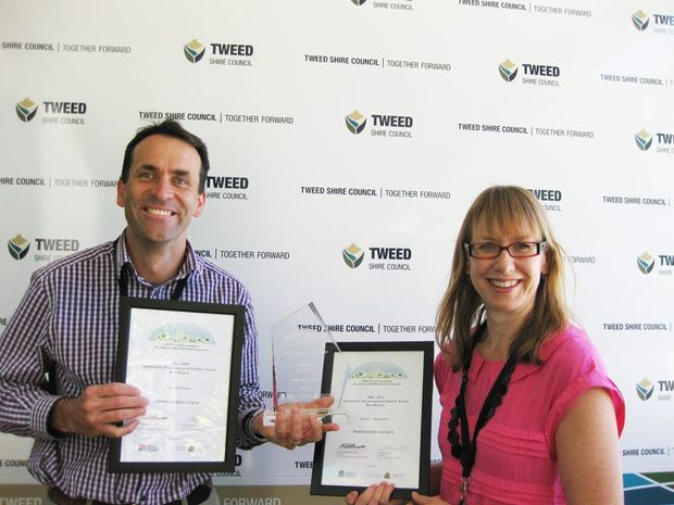 Tweed Shire Council's Senior Contracts engineer, Jason Young with Sustainability Program leader, Debbie Firestone and Council's award for sustainable procurement.