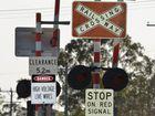 Railway crossing signals at at level crossing at Torbanlea. Photo: Tracey Joynson