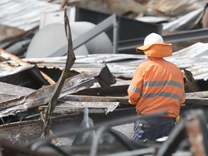 Crews clean debris from site of blaze