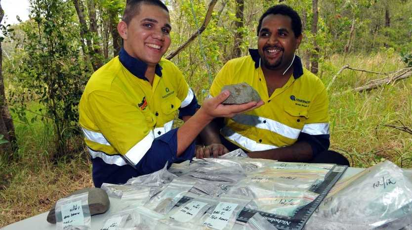HISTORIC DIG:Traditional custodians from Gurang Elijah-Baile Blackman and Gabriel Little are proud to work with the Skyringville Shell Midden Archaeological Group at the test pit where fascinating indigenous artefacts are being unearthed.