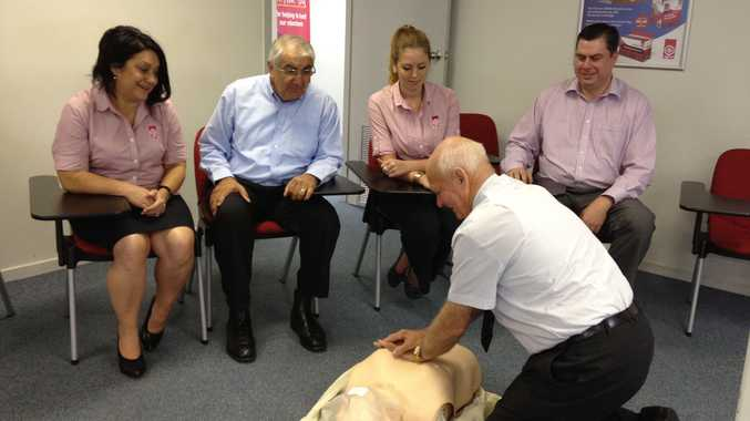 Lismore branch manager Nancy Casson, Lismore MP Thomas George, staff member Stephanie Williams, and St John's General Manager Brett Hamilton watching Trainer Alf Smith demonstrate his CPR technique while they enjoy the comfort of their new chairs.