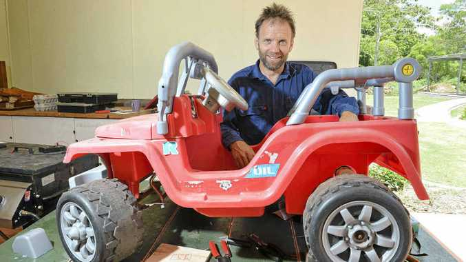 FIX IT: Paul Williamson works on a toy car at the Fixit Cafe in Maleny.