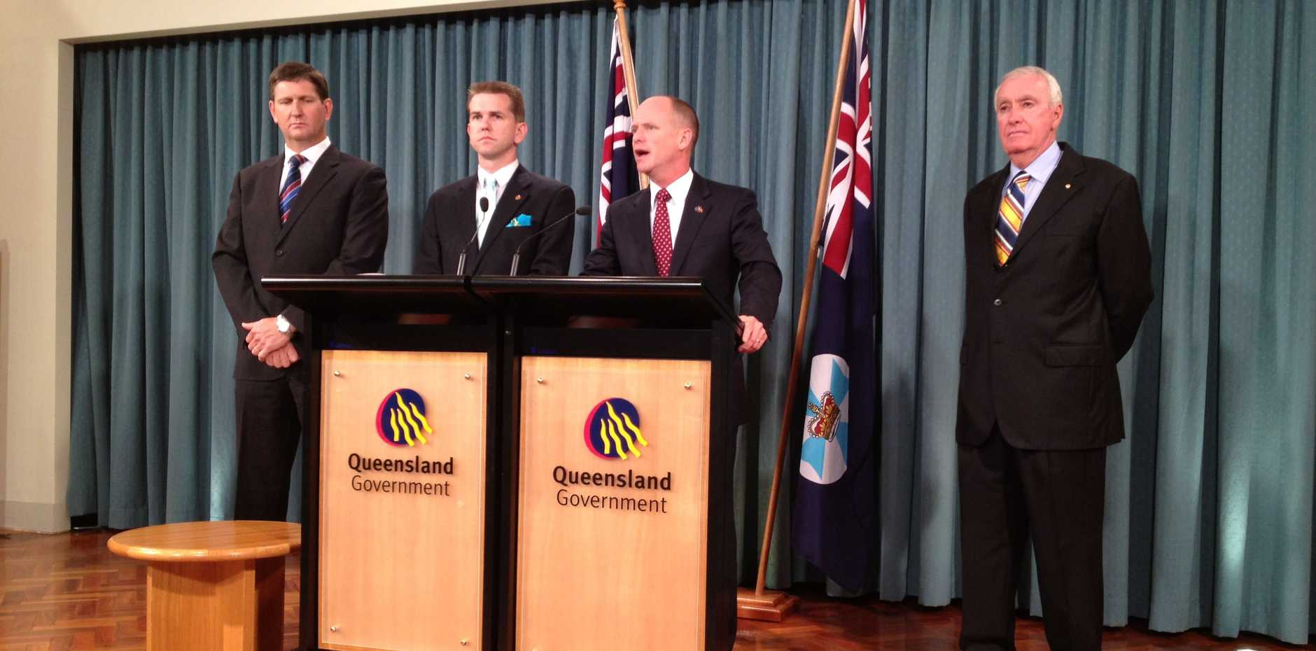 Queensland Health Minister Lawrence Springborg (L), Attorney-General Jarrod Bleijie and retired judge Richard Chesterman (Far R) are present while Premier Campbell Newman announces details concerning the payroll inquiry.