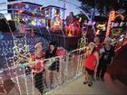 Light Up The City - best lights winners (L) Sonia and Samantha Sorensen from 47 Turnstone Boulevard at River Heads with their neighbours Brenda and Peter Bowman and Julie Carlton who helped them put it all together. Photo: Alistair Brightman / Fraser Coast Chronicle