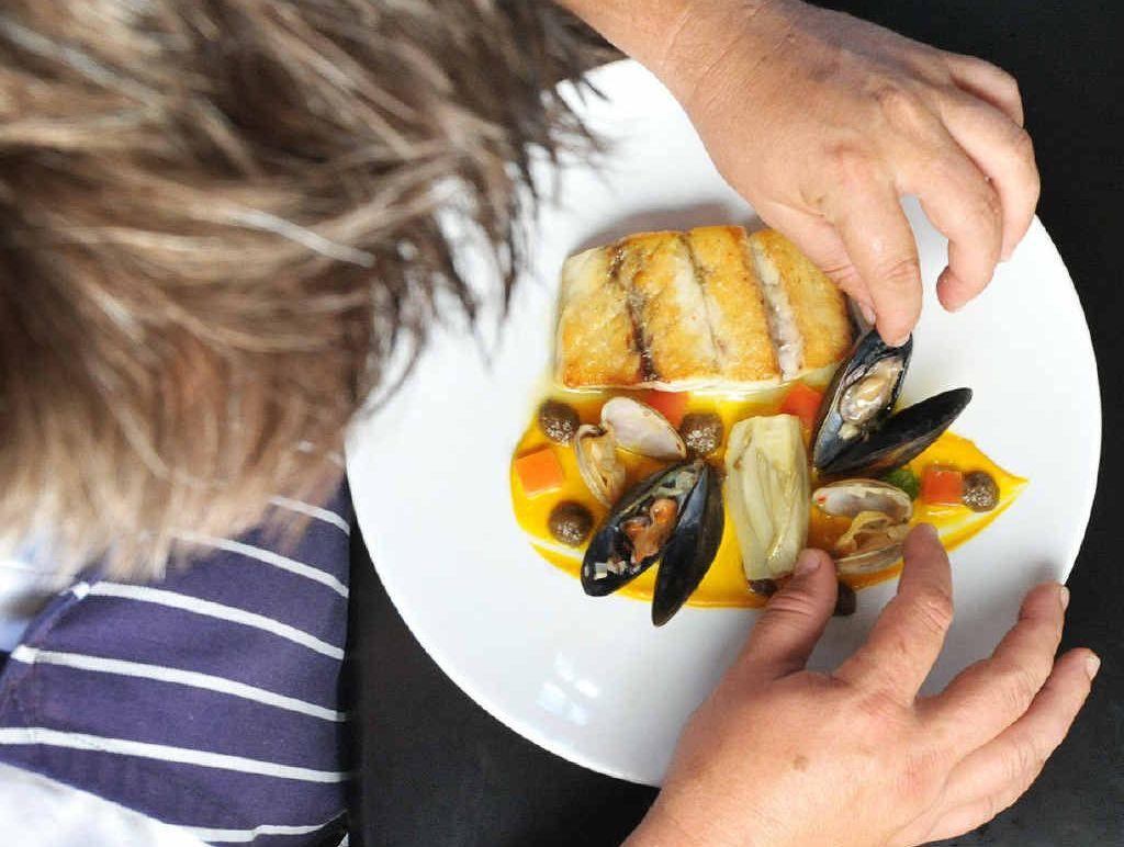 TANTALISING: Head chef at Stumps Hotel Jamie Pearce plates up a taste sensation.
