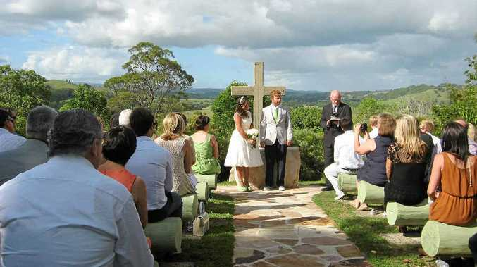 UNIQUE SETTING: Hayley Matthew of Surfers Paradise and Steve Kemp of the Bahamas were married by Rev John Thornton at the Bexhill open air cathedral.