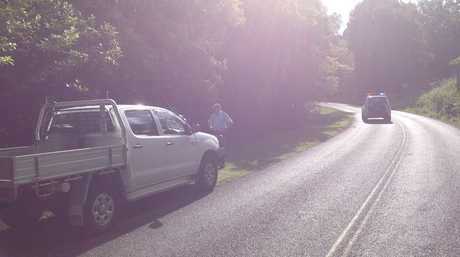 Police examine a vehicle that hit and fatally injured a woman at Lismore Heights this morning.