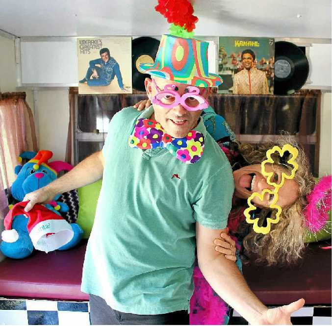 IT'S THE VAN, MAN: Chris and Anita Lee just love hamming it up in their colourful mobile photo booth.