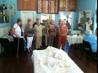 Still from a video of Lismore CWA members singing at a Christmas function.
