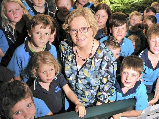 PRIVILEGED FAREWELL: Genevieve Kenna with students on her last day at North Arm State School after 17 years.