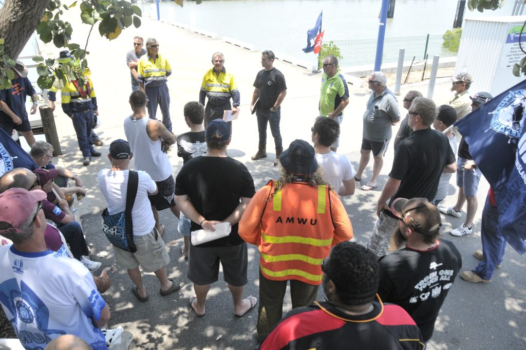 The Maritime Workers Union members, and other workers, held a rally at Gladstone Marina to protest 28 redundancies in tug-barge operations for Bechtel on the APLNG project.