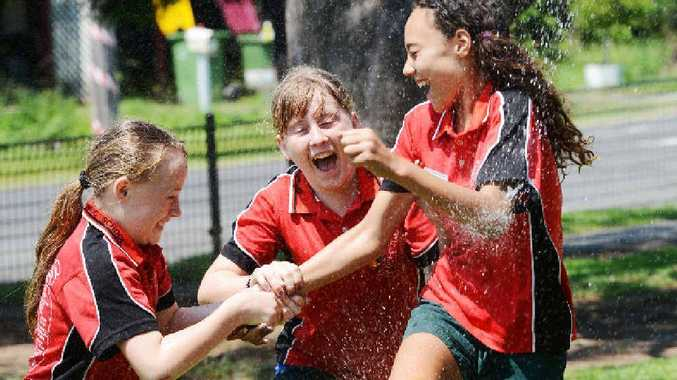 LAST HURRAH: Enjoying themselves under the sprinkler at South Lismore Public Schooll are Year 6 students from left Kayla Finnigan, Hannah Pierce and Taylor Small.
