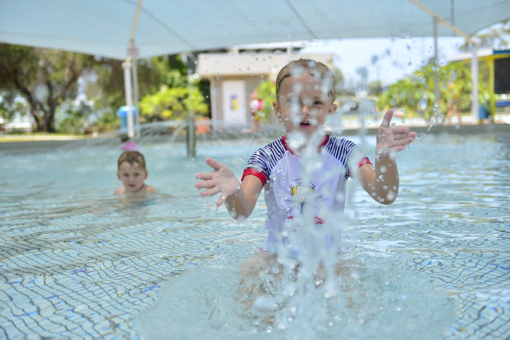 Paige MacCarthy, 6 and brother Blake, 3 cool off at the Gladstone Acquatic Centre. Photo Christopher Chan / The Observer