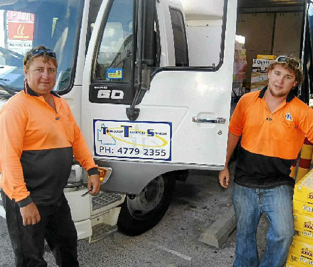 Joel (left) and Brad (right) are pictured delivering beer.