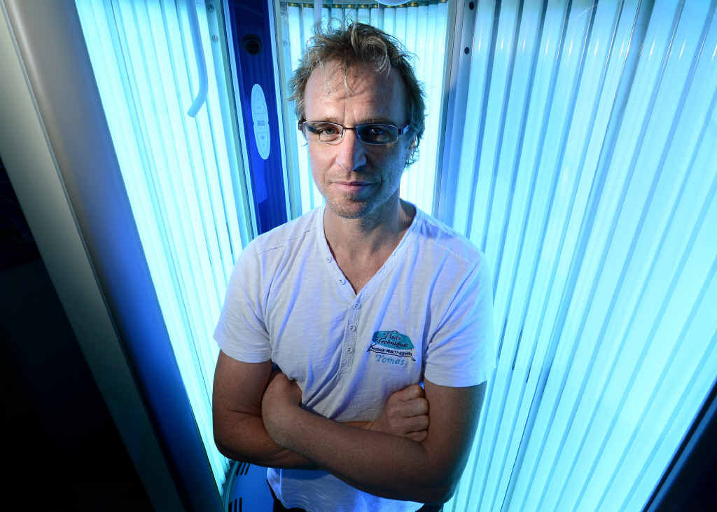 Owner of Body Techniques Ipswich Tomas Hamilton with his solarium which he will continue to operate.