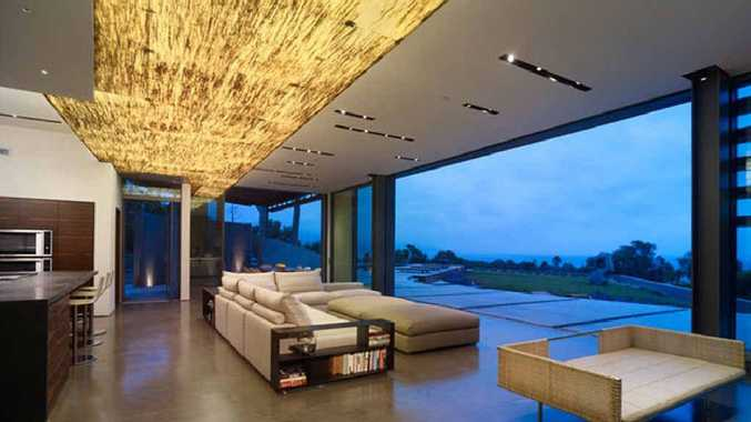 Griffin Enright Architects in California used a custom ceiling lightbox in gold for a feature at this Malibu home.
