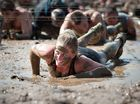 A competitor in the Sydney Tough Mudder event gets into the spirit of the obstacle race.