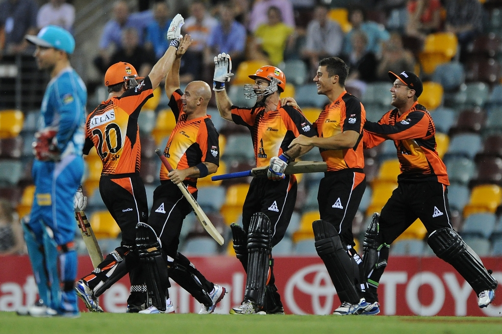 Scorchers players celebrate victory after the Big Bash League match between the Brisbane Heat and the Perth Scorchers at The Gabba on December 18, 2012 in Brisbane, Australia.