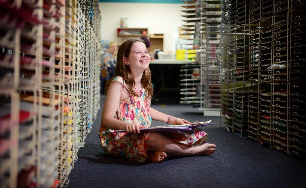 Naomi-Jon Redshaw, 12, enjoys a school holiday activity at Scrapbook Fantasies, Toolooa St, Gladstone.