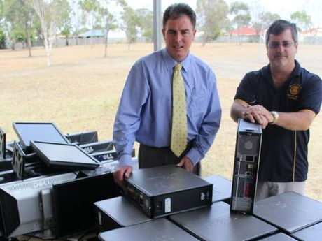 Fraser Coast Mayor Gerard O'Connell and Rotary Club of Hervey Bay Sunrise president Craig Winter inspect the 40 computers that will be sent to help Fijian school students.