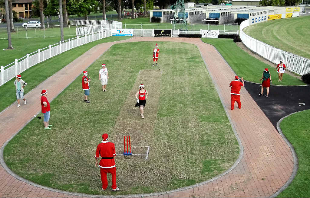 SANTAS ONLY: Santas parade their cricket skills at Grafton Racecourse on Saturday. Photo: Lynne Mowbray