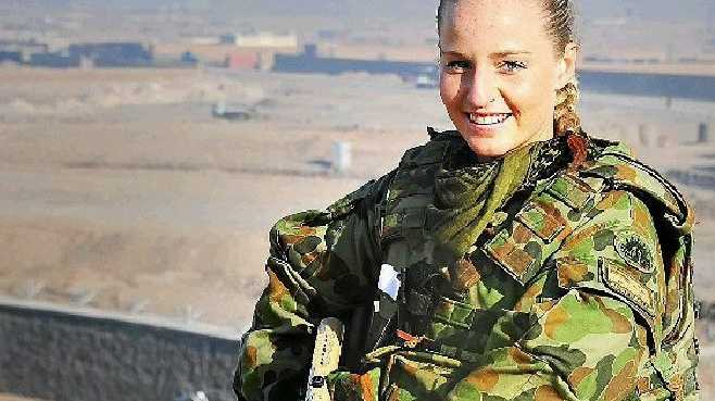 A TYPICAL Sunshine Coast Christmas for Lance Corporal Justine Peronchick involved dinner with friends and family and a splash in the ocean.