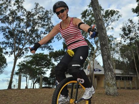 Janita Knowles, 52, on her municycle - the mountain bike version of a unicycle - cruising the Esplanade.