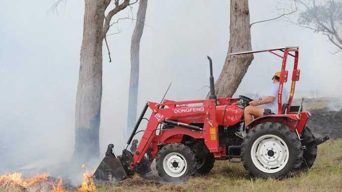 Land owner Trevor Davidson creating a firebreak behind houses in Karinya Circuit at Sunshine Acres.