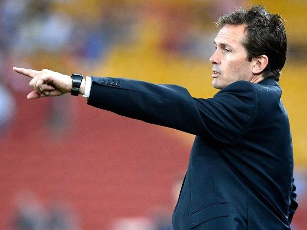 Coach Mike Mulvey of the Roar gives out instructions to his players during the round 12 A-League match between the Brisbane Roar and the Perth Glory at Suncorp Stadium on December 21, 2012 in Brisbane, Australia.