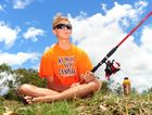 WEATHER PIC: Taylor Paul, 16, enjoying the day beside the Boyne River in Benaraby. Photo Tom Huntley / The Observer