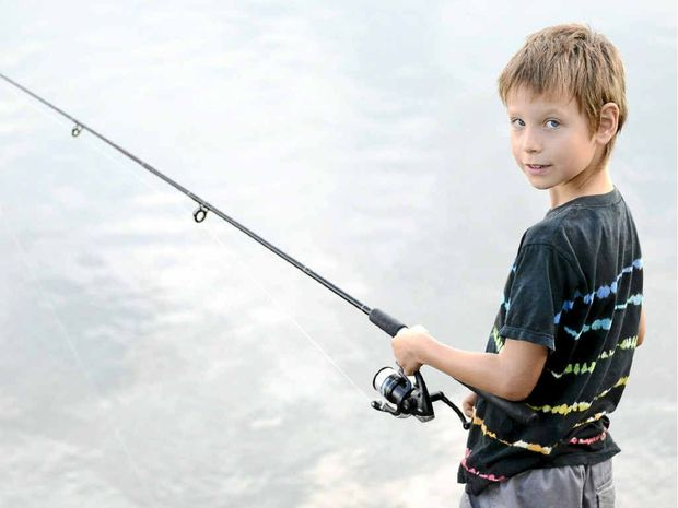 Kian Hoelker, 7, of Mullumbimby was fishing at Yamba Bay while his mum had a stall at the Yamba Markets on Sunday. Photo: Debrah Novak/The Daily Examiner