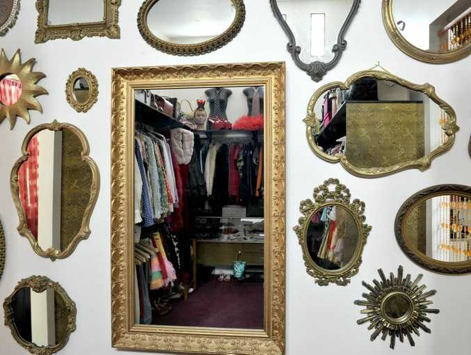 A cluster of gold framed mirrors in Deb and Andy's dressing room.