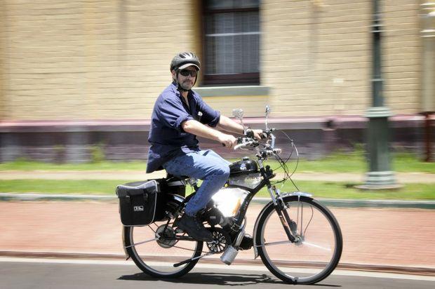 Alan Jones gets moving on his motorised bike.