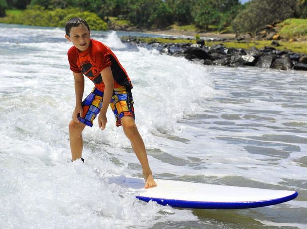 LEARNING FAST: Michael Symmons enjoying the waves at Nielson Park. Photo: Ben Turnbull / NewsMail