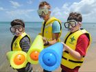 Scouts Chris Eaton, 10, Justin Patzwald, 17, and Jack Easton, 8, test out some of the equipment visiting scouts will use during jamboree beach activities in Torquay.
