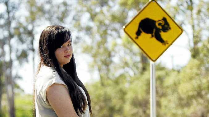 SICK ACT: Emily Furnell was brought to tears by finding a cat taped to a sign on Caboolture River Rd.
