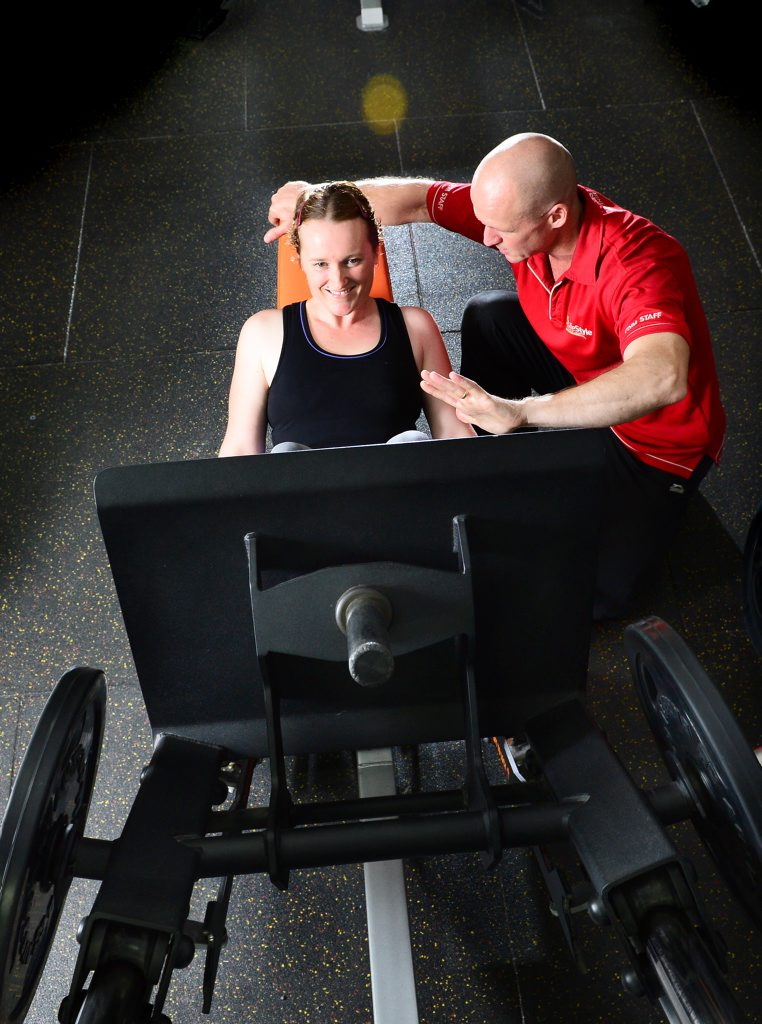 Personal Trainer Paul Florence encourages his client Emma Lennon during a workout at the Raceview Lifestyle Health Club.
