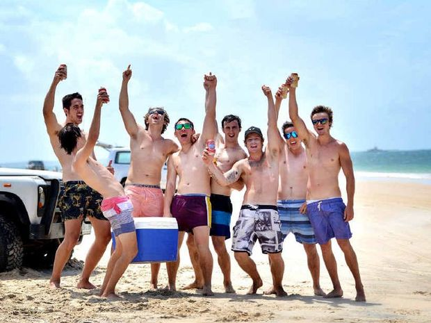 New Year revellers Kieren Askin, Matt Wiggins, Nelson King, Michael Murray, Andrew Wiggins, Ryan Wilson, Alec Noble and Daniel Krosch, from Kingaroy, get ready for a big day out at Inskip Point.