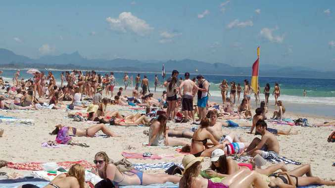LESS CROWDED: It wasn't just shopping and drinking either, there was a need to soak up some sun and the salt air on Main Beach, Byron Bay.
