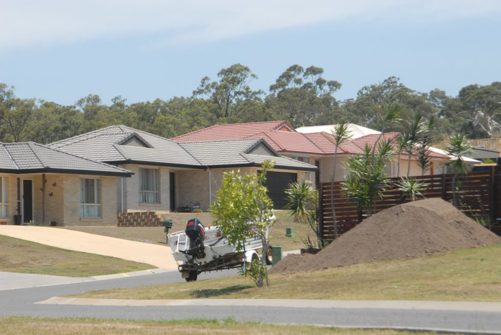 A property director says Gladstone's market may dip slightly after the boom, but it won't crash.