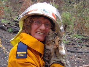 Volunteer firefighter rescues cat from blaze