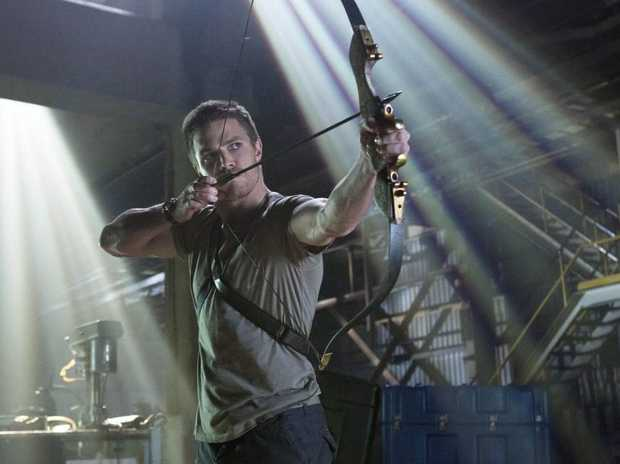 GOTTA LOVE A GUY WITH A BOW: Stephen Amell stars in Arrow, one of the top new shows for 2013.