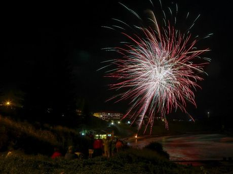 The fireworks explode above the Pacific Hotel in Yamba to bring in 2013 watched by thousands of people along the foreshore.