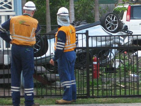 CRASH SITE: Power workers joined police and firefighters at the scene of the carnage in Glebe Rd.